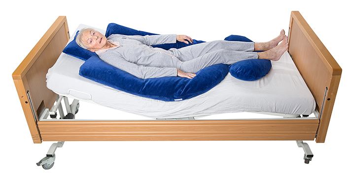 Supine position - Prevents slumping in bed
